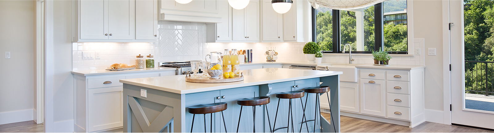 White kitchen with beautiful center table